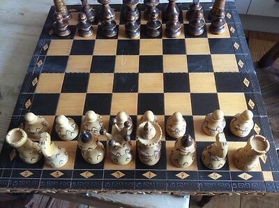 Hand Carved Ornate Wooden Chess Set And Folding Board