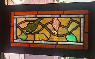 1 of a matched pair of unusual stained glass windows