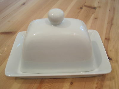 A large  high domed lidded butter dish white ceramic