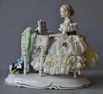 Beautiful Porcelain Dresden Lace Figurine Unterweissbach Playing Piano Germany.