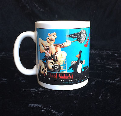 Wallace & Gromit 1989 Mug Chasing A Penguin On A Train With A Butterfly Net