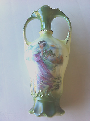 green porcelain vase with lady in pink gown
