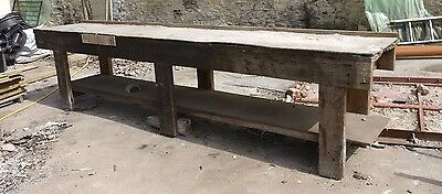 Wooden work bench 10 ft long. Very strong