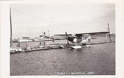 RP: Small float airplane at dock , WIARTON , Ontario , Canada , 30-40s