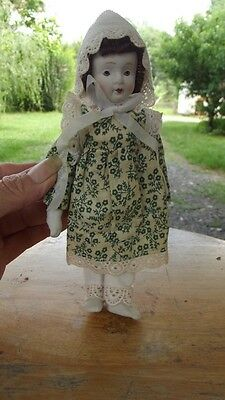 Small Porcelain doll -   7""