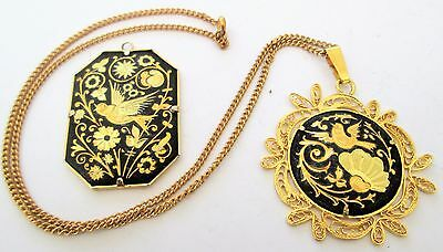 Two good quality vintage Damascene gold metal bird & flower design pendants