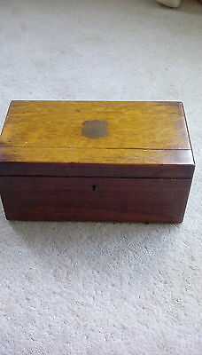 Antique wooden box with brass shield inlay on lid