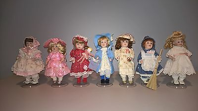 Paradise Galleries Days of the Week Collection Porcelain Dolls Complete Set of 7