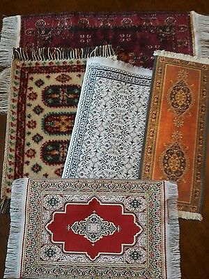 Four lovely doll house rugs and a runner