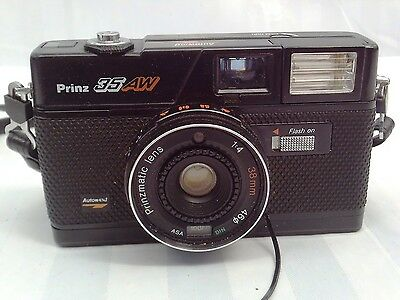 Vintage 35mm Prinz 35AW manual camera with unused film and original pouch