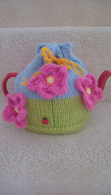 Hand knitted flower garden tea cosy