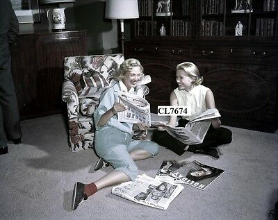 Grace Kelly Reading Magazines with a Friend Photo
