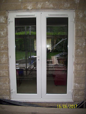 used white upvc double glazed french patio doors exterior