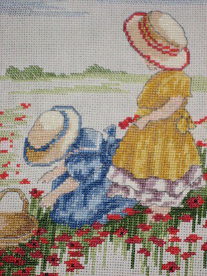 Completed cross stitch of girls and poppies. 27 x 30 cms