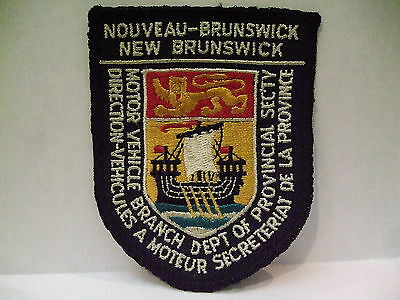 police patch  NEW BRUNSWICK CANADA MOTOR VEHICLE BRANCH ENGLISH & FRENCH