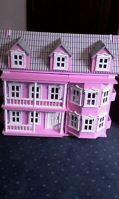 Pink Wooden Dolls House with dolls and furniture
