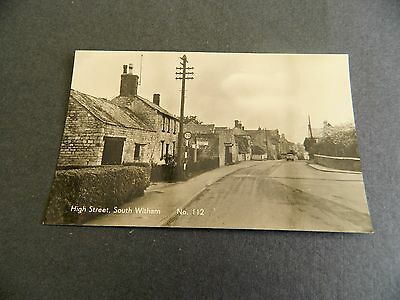Real photo postcard of High street, South Witham, Grantham