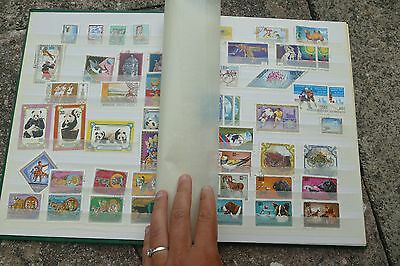 Stamp Album 2 - worldwide 20thC 1900s postage stamps postal kiloware 16 pages