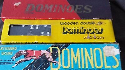 two john sands vintage board games and three sets of dominoes.