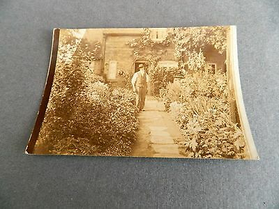 Edwardian photo postcard of an old man in front of his cottage