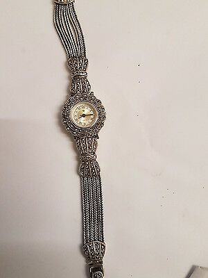 A vintage solid silver ladies marcasite watch.