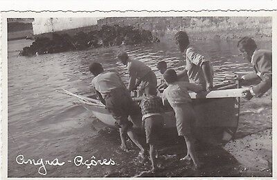 RP: ANGRA, Azores, Portugal, 20-30s; Fishermen push boat into water