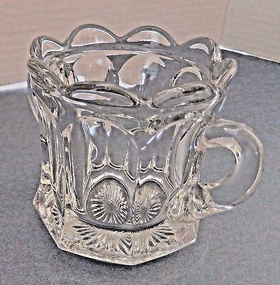 Clear pressed glass sugar bowl, 8 side panels, star burst bottom, scalloped top
