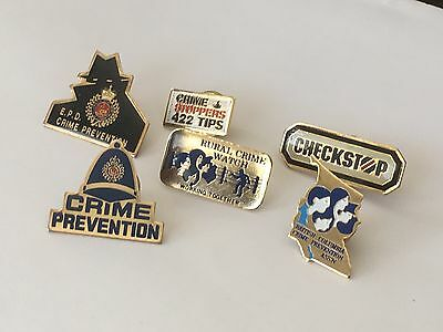 Police pins Edmonton British Columbia BC Crime watch prevention stoppers lot