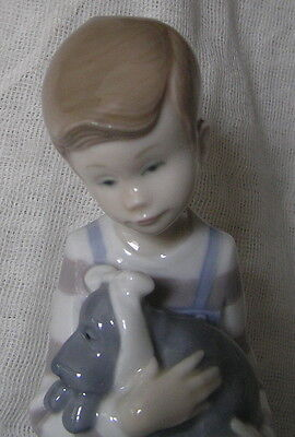Beautiful Figurine From Nao By Lladro Boy Holding Poorly Puppy