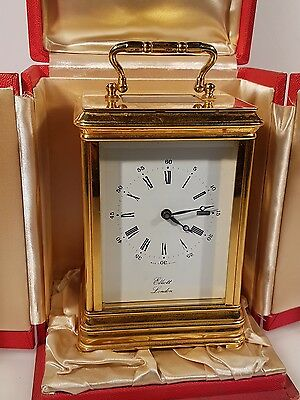 Very Good quality Heavy Brass Elliott Four Glass Carriage Clock and Display Case