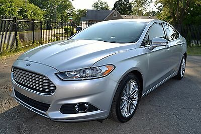 2014 Ford Fusion SE Sedan 4-Door 2014 Ford Fusion SE Sedan Super Clean, Rear Sensors, Rebuilt Title NO RESERVE