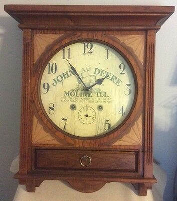 "19.5""X16""X5""wooden John Deer wall clock with chime/ double dial tested ok."