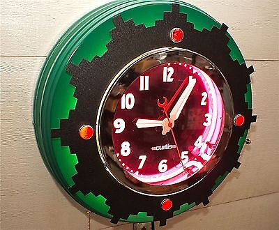 "A 22"" Curtis Neon Clock, Ruby Jeweled  Aztec, A neon clock for a lifetime."