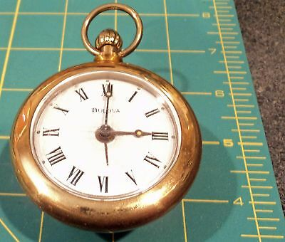 BULOVA gold color ALARM travel CLOCK looks like a pocket watch made in GERMANY