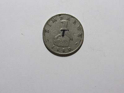 Old Zimbabwe Coin - 1980 1 Dollar -Circulated, scratches, ink writing, rim dings