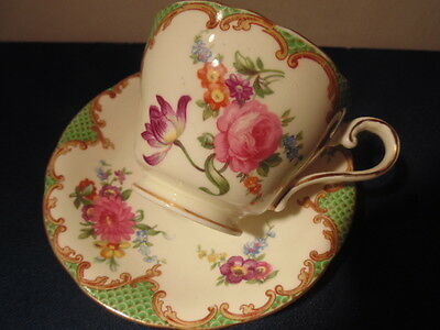 aynsley cup and saucer,green with rose design,gold trim