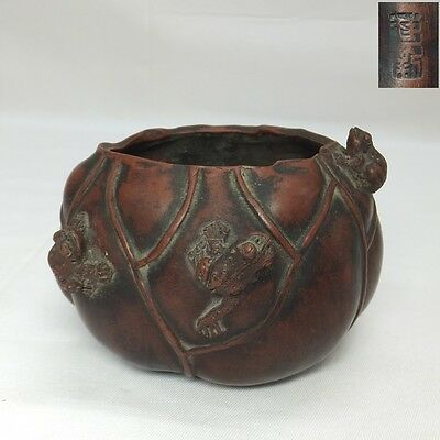 E667: Chinese unglazed pottery incense burner of lotus leaf shape with frog