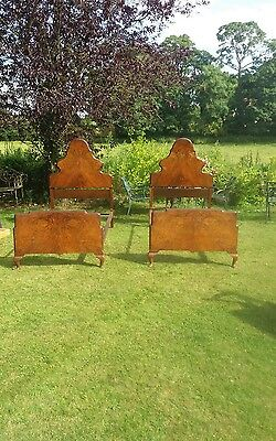 Stunning pair of  1920s burr walnut single bed frames.With wooden mattress bases