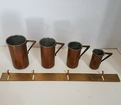 4 VINTAGE COPPER MEASURING CUPS W/BRASS HANDLES and BRASS HANGER