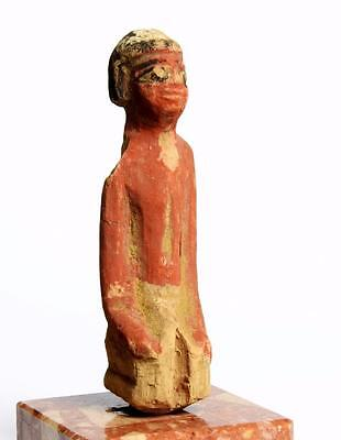 Egyptian Middle Kingdom wood servant: Circa 2000-1800 BC.