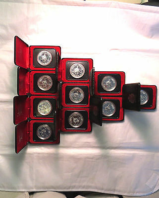 10pc. Lot Canadian Silver Proof Like Dollars -1875-1975 Calgary $ -.500 Silver !