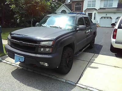 2003 Chevrolet Avalanche  2003 Chevrolet Avalanche 1500 Crew Cab 4WD 305 Tires. Strong