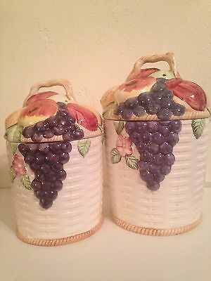Porcelain canisters with fruit and grapes; set of 2