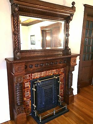 Beautiful restored fireplace mantle with beveled mirror and antique tile