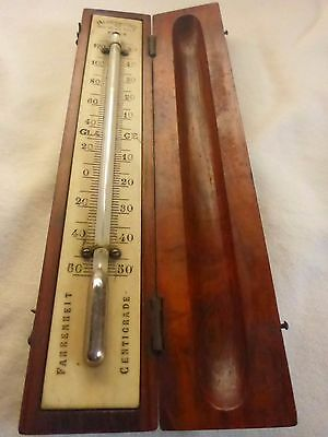 Antique thermometer in Wooden case.