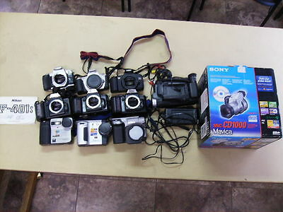 Cameras Assorted Lot 1 Pentax,1 JVC VHS, 2 Cannon, 3 Nikon, and 4 Sony. 11 Total
