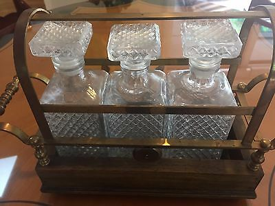 Italian tantalus with three decanters