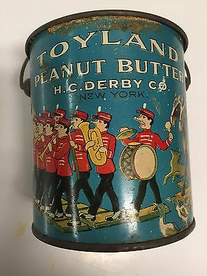 Toyland 1-Pound Peanut Butter Advertising Tin with Handle Circa 1920s