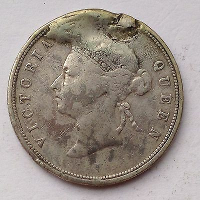 Hong Kong 50 Cents silver coin, issued in 1892 H, damaged condition