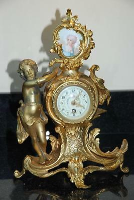 A 19th Century gilded Spelter and Porcelain Panel Mantle Clock